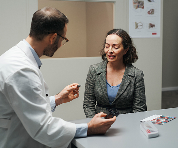 Hearing care professional advising a patient.
