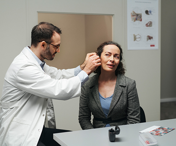 ReSound hearing care fitting a patient with a ReSound hearing aid.