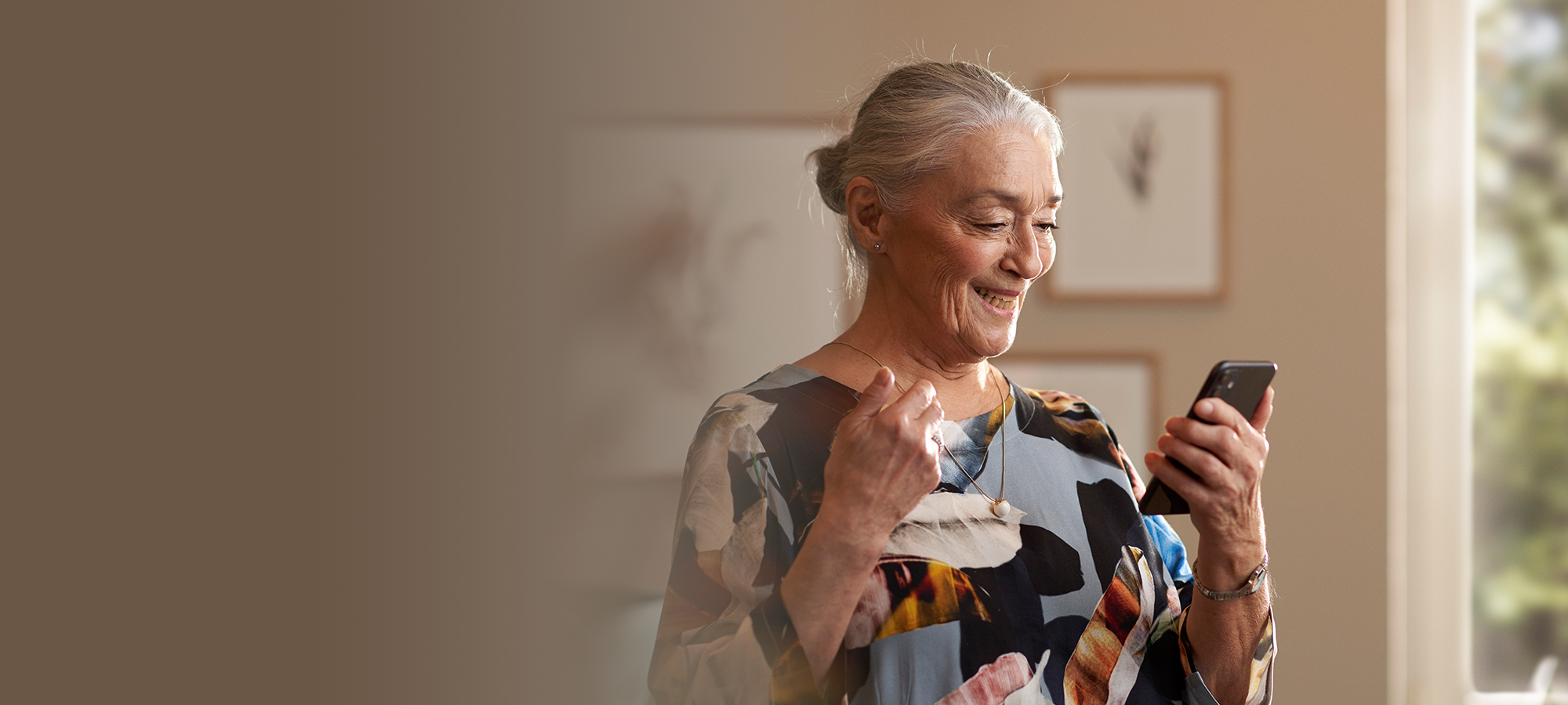 Woman wearing ReSound hearing aids and using ReSound Assist.